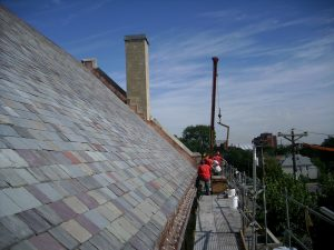 roofing contractor working on slate roof